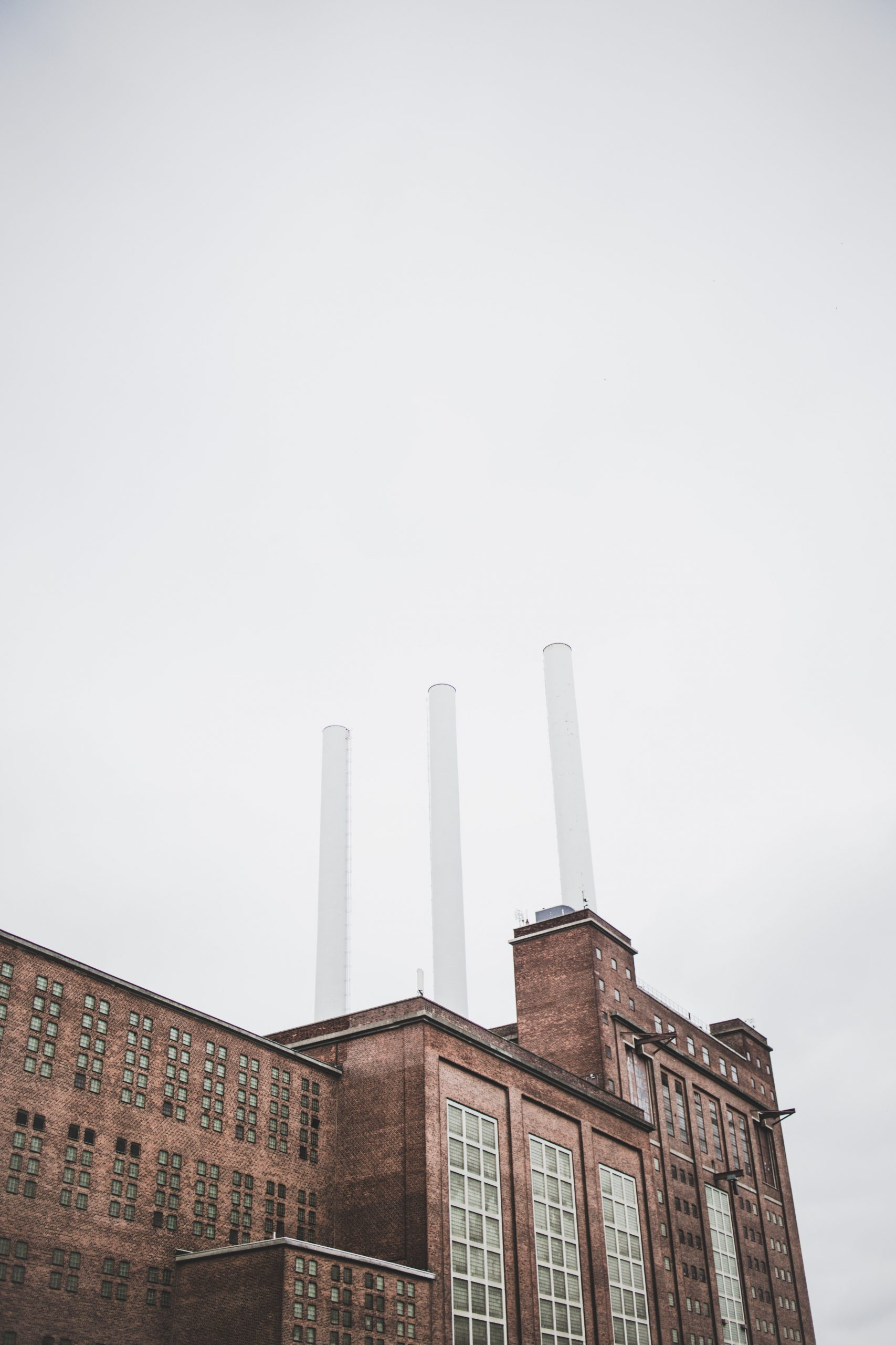 brown factory under clear sky